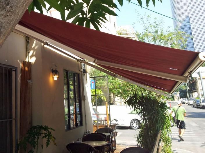תיקון סוככים חשמליים בבית קפה בתל אביב